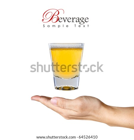 a Glass of Beer over the human hand with copy space - stock photo