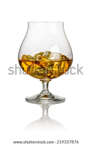 A glass of brandy on a white background - stock photo