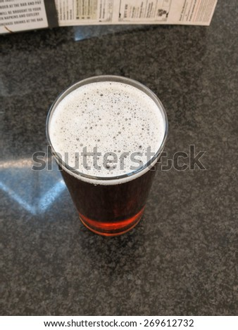 a glass of British cask ale - stock photo