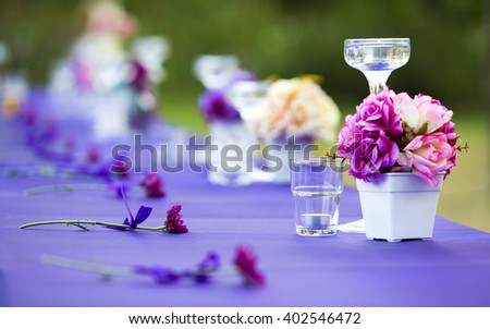 A glass of champagne, flowers on the table - stock photo