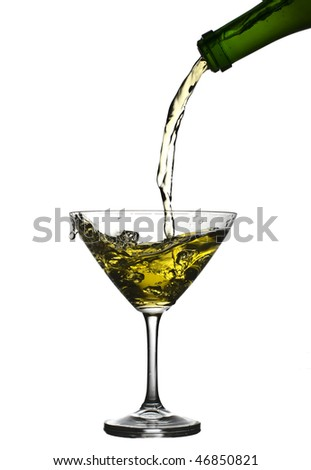 A glass of champagne in which wine is poured from a bottle on a white background