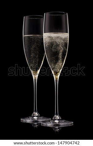 A glass of champagne, isolated on a yellow background. - stock photo