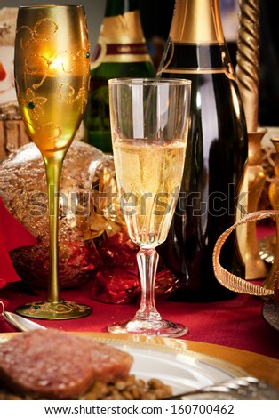 A Glass of Champagne on a decorated Christmas day dinner table. - stock photo