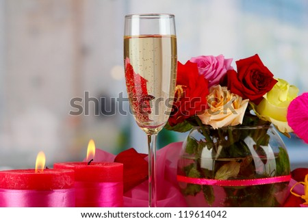 A glass of champagneon on celebratory table room background - stock photo