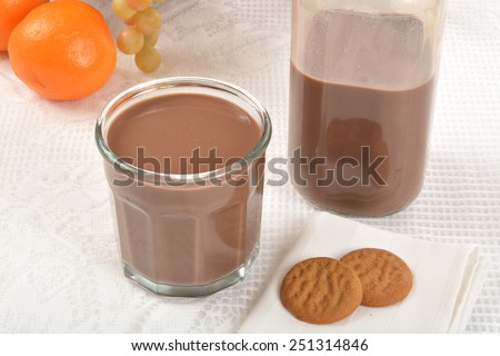 A glass of chocolate milk and ginger snap cookies  - stock photo