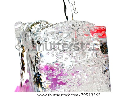 a glass of cool sparkling water with blossoms - stock photo