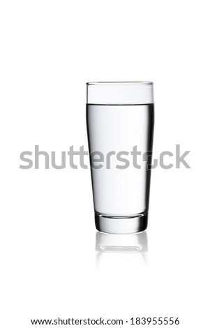 A glass of  drinking water on white isolated willi cup background with reflection - stock photo