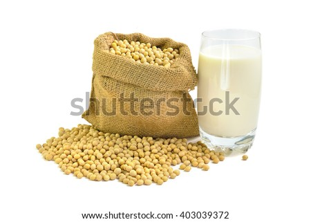 A glass of fresh soy milk and soy beans isolated on white background, selective focus.  - stock photo