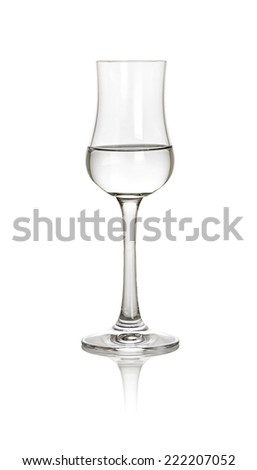 A glass of grappa on a white background - stock photo