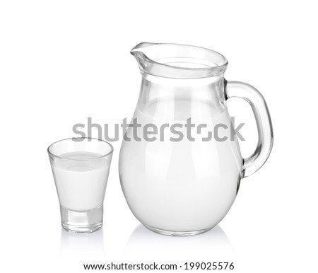 A glass of milk and a milk jug on white - stock photo
