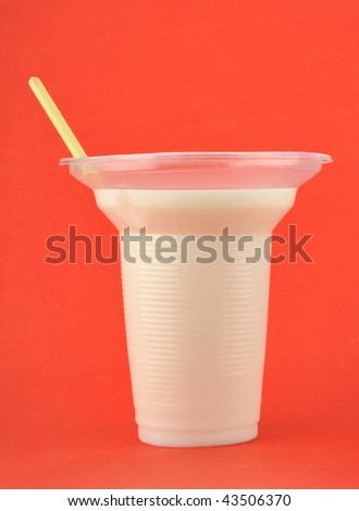 A glass of milk on isolated red background - stock photo