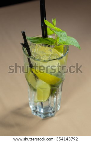 A glass of mojito cocktail on the table