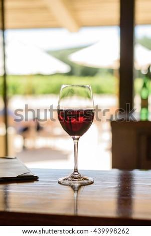 A glass of Pinot Noir from Robert Mondavi Vineyard in Napa Valley, California - stock photo