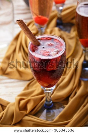 a glass of red sangria with cinnamon for refrehments - stock photo