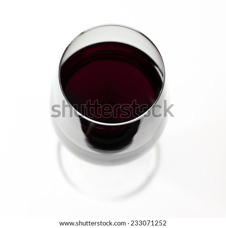 A glass of red wine from above on white background - stock photo