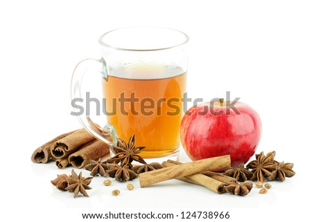 A glass of tea with apple and spices,on a white background. - stock photo