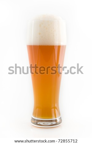 A glass of wheat beer on white background