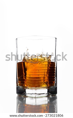 A glass of whiskey on a white background.