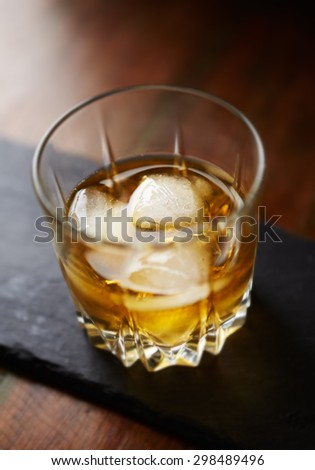 A glass of whiskey wit ice - stock photo
