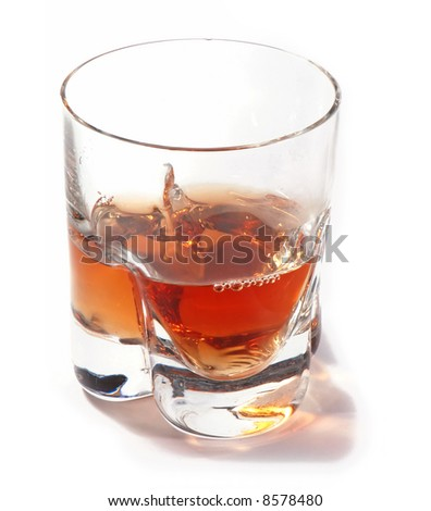 A glass of whisky on white background