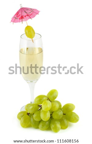 A glass of white wine and a bunch of grapes isolated on a white background - stock photo