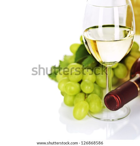 A glass of white wine and grape over white - stock photo
