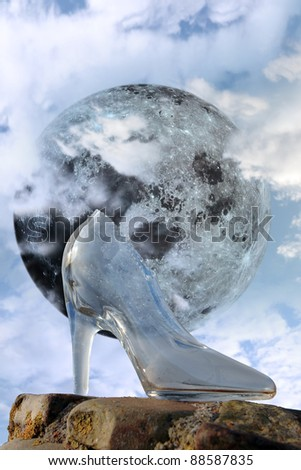 a glass slipper in a cloudy blue sky background with full moon at midnight - stock photo