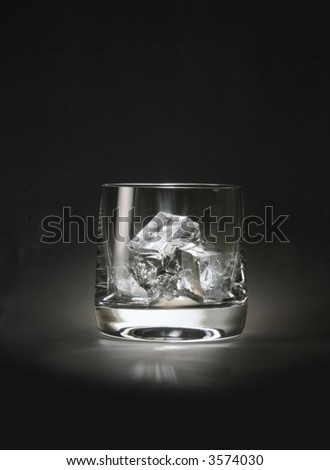A glass with ice cubes - stock photo