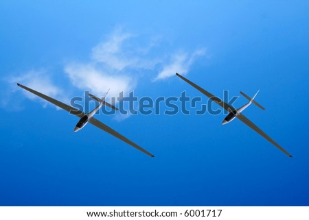 A gliders shot from below against a blue sky - stock photo