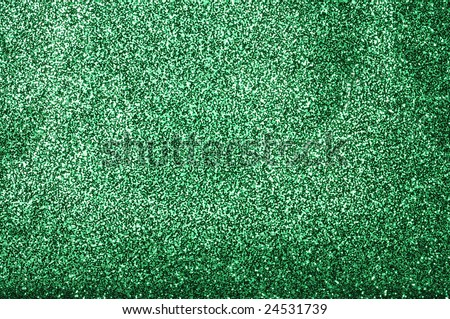 A glittery green paper decorative background - stock photo