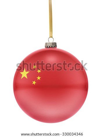 A glossy christmas ball in the national colors of China hanging on a golden string isolated on a white background.(series) - stock photo