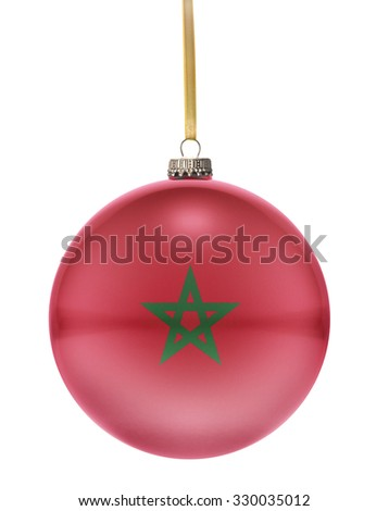 A glossy christmas ball in the national colors of Morocco hanging on a golden string isolated on a white background.(series) - stock photo