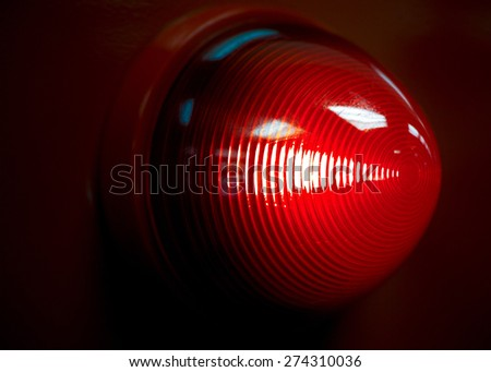 A glowing red emergency light. - stock photo