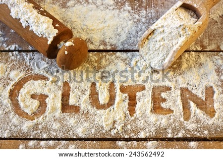 a gluten word with wood background - stock photo
