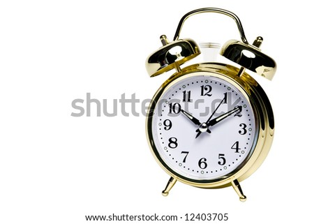 A gold alarm clock isolated on white. The alarm is ringing. - stock photo