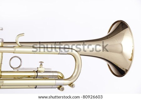 A gold and brass trumpet or cornet isolated against a white background. - stock photo