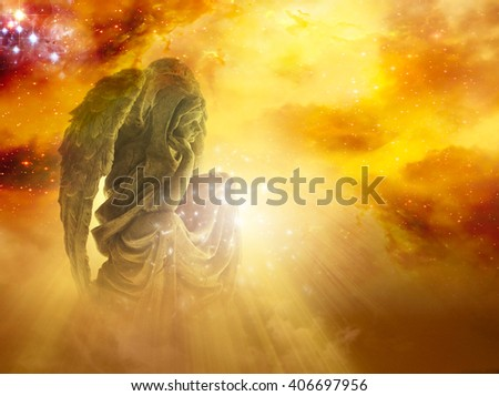 a gold angel with sunrise sky - stock photo