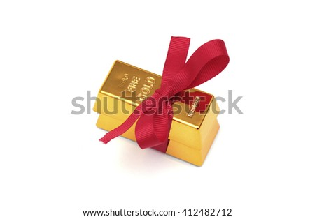 A gold bar with a red ribbon - stock photo