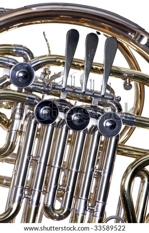 A gold brass French horn close up isolated against a white background  in the horizontal format. - stock photo