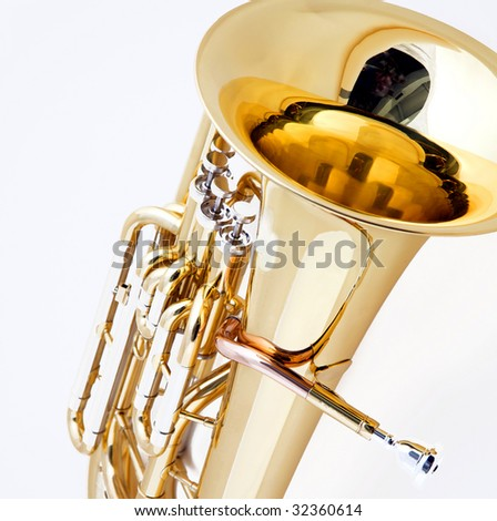A gold brass tuba euphonium isolated against a white background in the square format. - stock photo