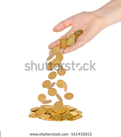 A gold coins fall out of the hands on a pile of gold coins - stock photo