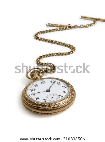 A gold vintage watch with chain lying on a white background