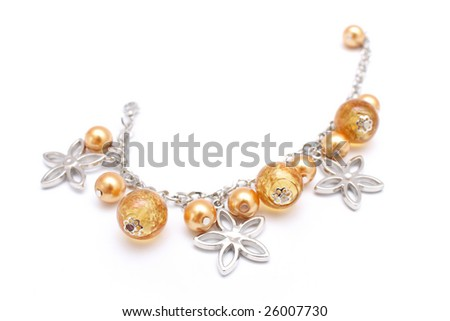 A golden beads bracelet isolated on white background.