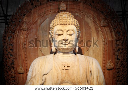A golden Buddha sitting in the Asian Museum - stock photo