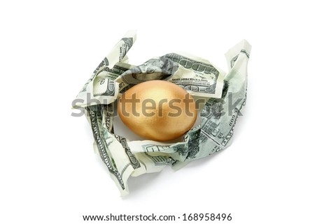 A golden egg in dollars isolated on white background - stock photo