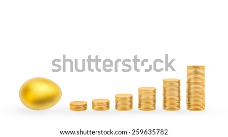 A golden egg laying with ascending gold coin stacks: A golden egg opportunity concept of a fortune and a chance to be rich - stock photo