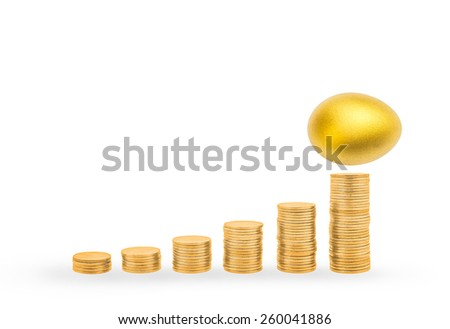 A golden egg on top of the highest point of ascending gold coin stacks: A golden egg opportunity concept of a fortune and a chance to be rich - stock photo