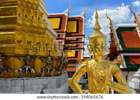 A Golden Kinnari statue at the Temple of the Emerald Buddha  (Wat Phra Kaew) , Bangkok, Thailand  - stock photo