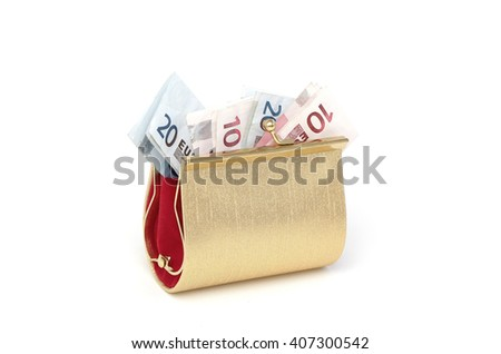 A golden purse filled with euro bills - stock photo