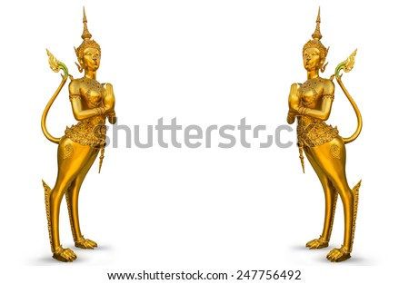 A Golden statue at the Wat Phra Kaew - stock photo
